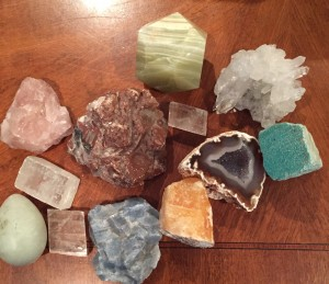 Assorted calcites: pink, clear, orange, rose quartz chunk, jade egg, amazonite, geode, green and clear quartz.